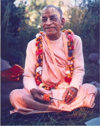 Prabhupada smiling with flower